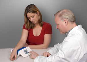 Doctor and patient using the AGE Reader mu - connect